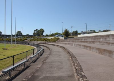 concrete seating area at a football oval