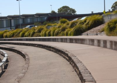 a close up picture of the concrete seating at a football oval