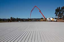 Large-concrete-pad-for-cows-at-farm